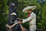 Picture of Franco Gallardo with a horse.  / Una foto con Franco Gallardo con un caballo
