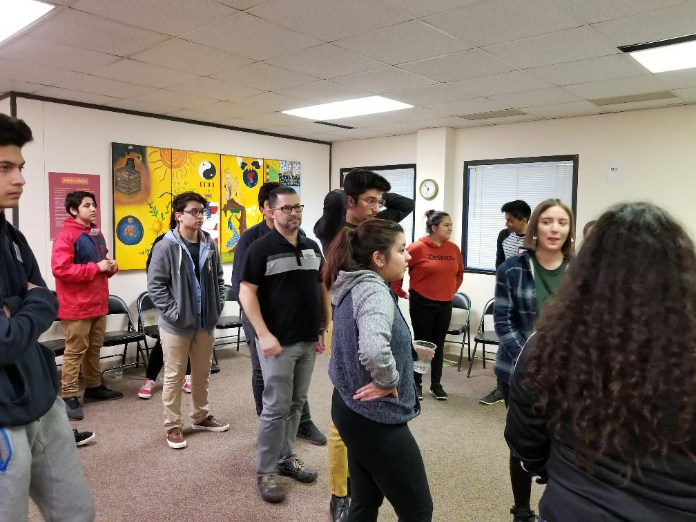 Group of El Pueblo youth during a workshop