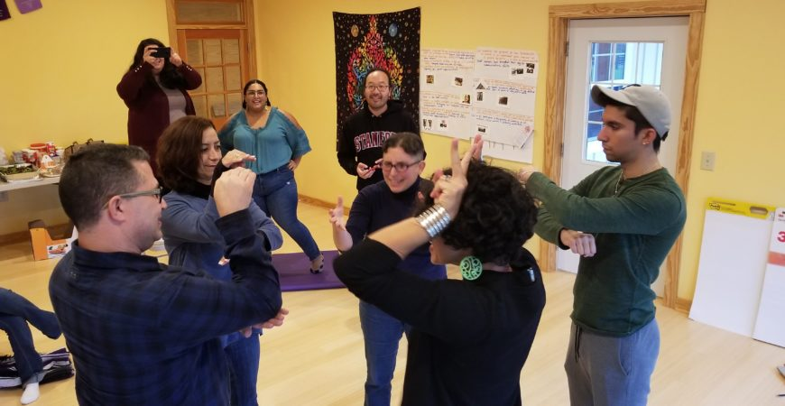 El Pueblo staff members and consultants playing a game at our 2018 staff retreat.