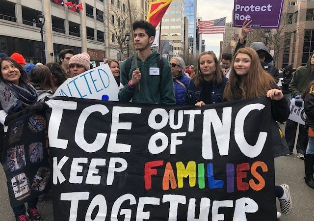 "HKonJ March, youth holding a ""ICE out of NC Keep Families Together"" Banner"